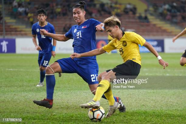 Muhammad Akhyar Rashid of Malaysia and William Grierson of the Phillipines in actionduring the AFC U23 Championship qualifier between Malaysia and...