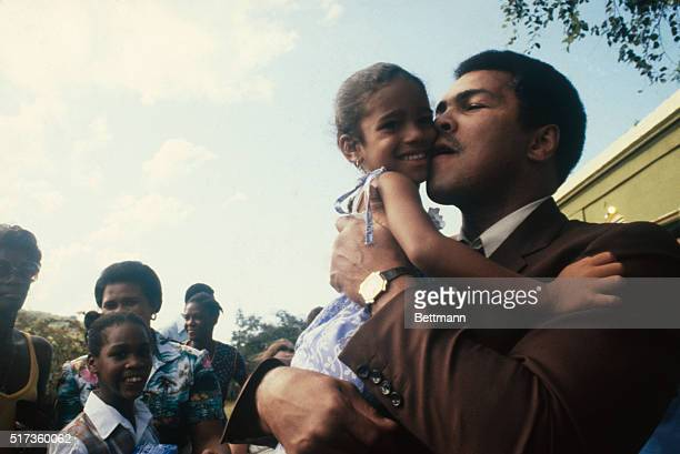 Muhammad Ali amidst Cruzan youth on his recent trip to the US Virgin Islands 'The Champ' spent 3 days on both St Croix and St Thomas meeting island...