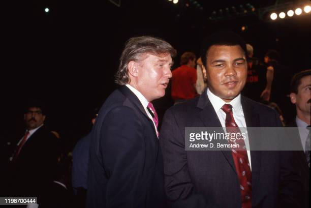 Muhammad Ali and Donald Trump attend the Evander Holyfield vs George Foreman boxing match at the Trump Plaza Hotel and Casino