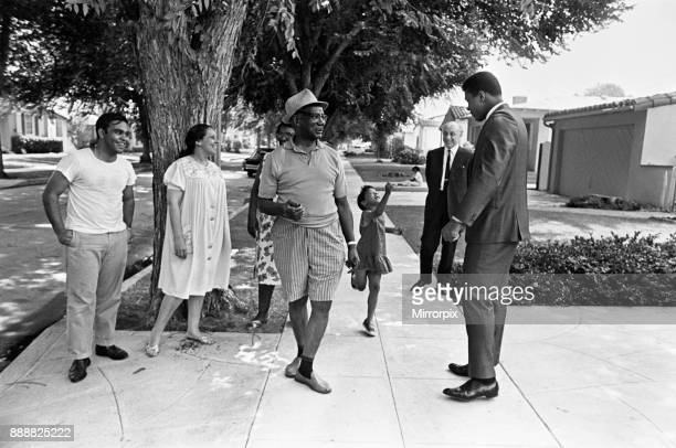 Muhammad Ali and Donald Zec Daily Mirror reporter out and about meeting fans 31st August 1967