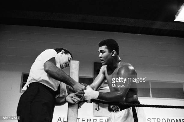 Muhammad Ali and Ernie Terrell met to end the confusion about who was the legitimate heavyweight champion Ali getting ready for training 1st February...