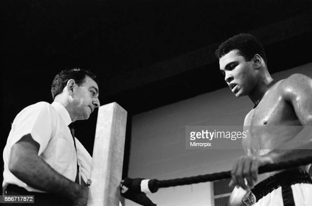 Muhammad Ali and Ernie Terrell met to end the confusion about who was the legitimate heavyweight champion Ali with trainer Angelo Dundee in the gym...