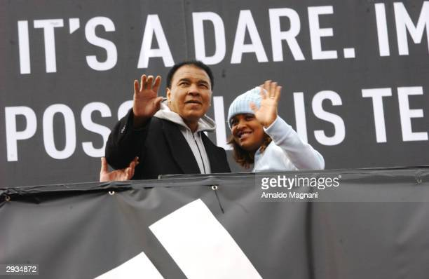 Muhammad Ali and his daughter Laila attend the Addidas debut of their new global brand advertising campaign where they unveiled a new bill board...