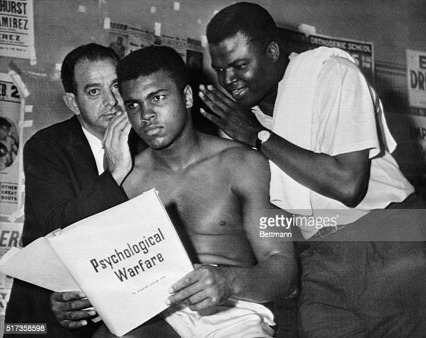 Muhammad Ali and his trainers discuss psychological warfare in preparation for his heavyweight championship bout against Sonny Liston