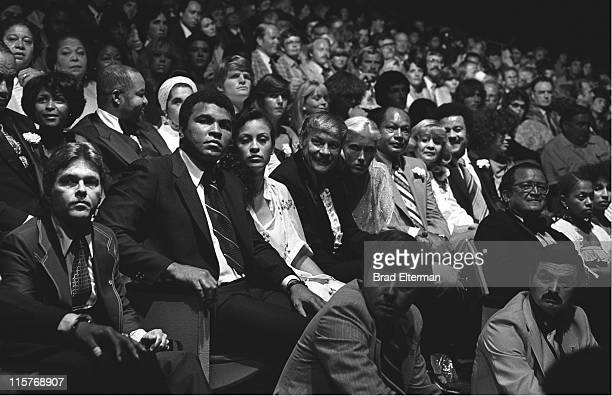Muhammad Ali and his wife Veronica Porsche Ali Dr Jerry Buss Dr Buss's date Mayor Thomas Bradley and his wife Ethel Bradley at a charity concert at...