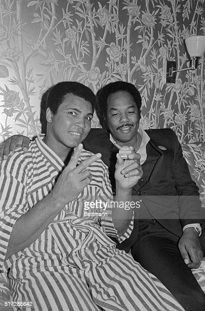 Muhammad Ali and longtime friend and business associate Howard Bingham relax in Ali's hotel room here on the afternoon prior to Ali's defense of his...