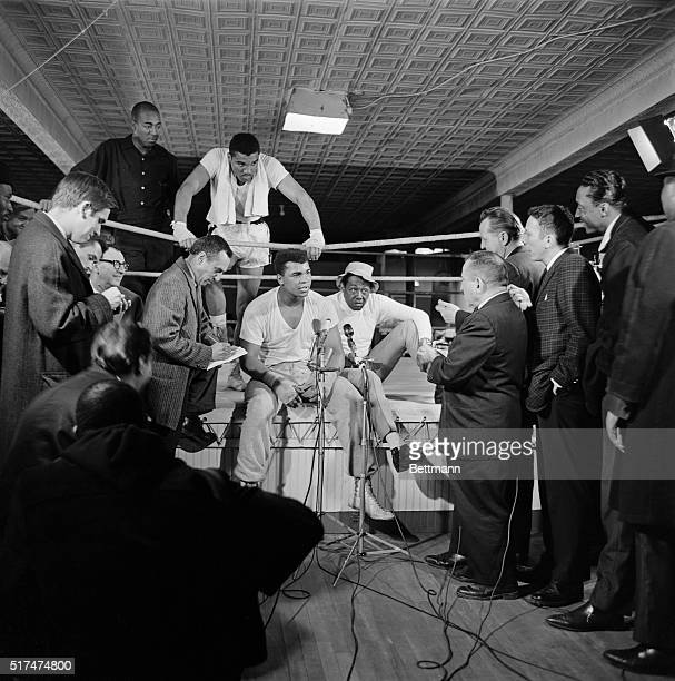 Muhammad Ali better known as Cassius Clay talks to newsmen after his first workout since a hernia operation forced the postponement of his...