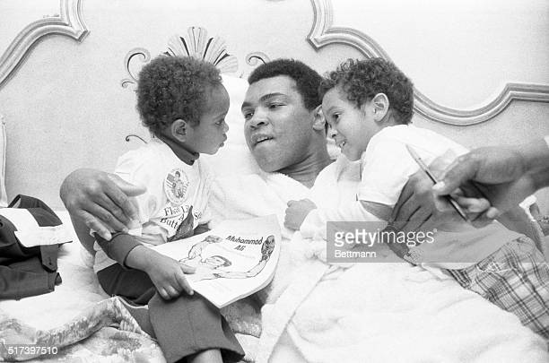 Muhammad Ali embraces Sedar Chappelle and his brother Dave of Silver Spring Maryland during a visit Sedar and his parents paid to the champ's hotel...