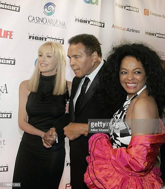Muhammad Ali escortd by Sharon Stone and Diana Ross