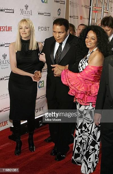 Muhammad Ali escorted by Sharon Stone and Diana Ross