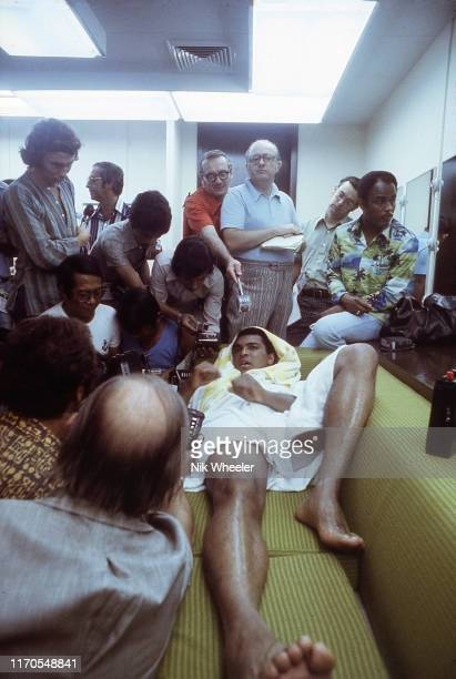 Muhammad Ali fields questions from the Filipino and International Press as he relaxes in his dressing room after training session days before his...