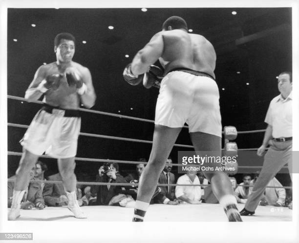 Muhammad Ali fights Roger E Mosley in rink in a scene from the film 'The Greatest' 1977