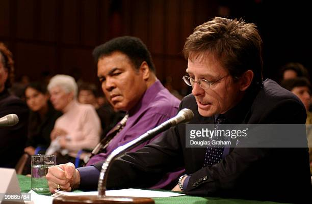 Muhammad Ali former heavyweight boxing champion listens as Michael Fox actor/founder Michael Fox Foundation for Parkinson's Research makes his...