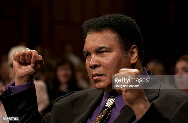 Muhammad Ali former heavyweight boxing champion strikes his trade mark pose during the Labor HHS Education and Related Agencies Subcommittee hearing...
