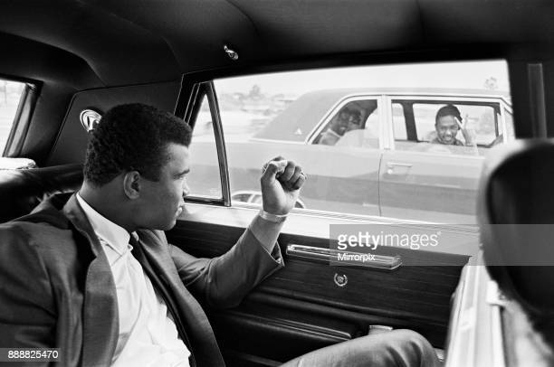 Muhammad Ali gestures to a driver in another car 31st August 1967