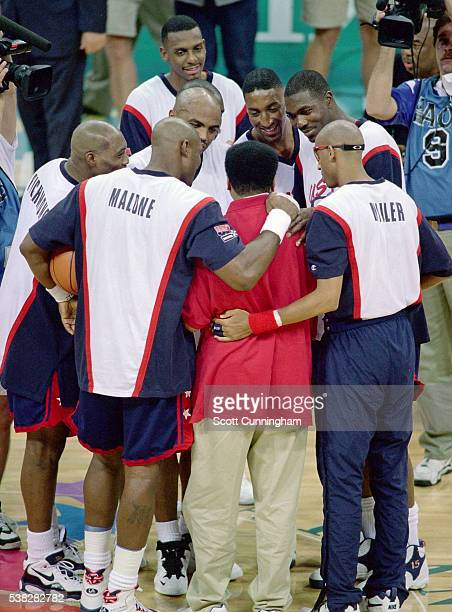 Muhammad Ali huddles with the dream team during half time of the gold medal game against Yugoslavia after receiving the gold medal which replaces the...