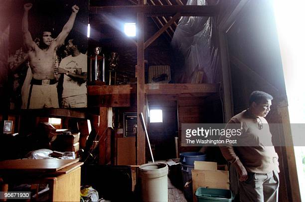 Muhammad Ali in the barn where he would train for fights in the past, now full of memorabilia.