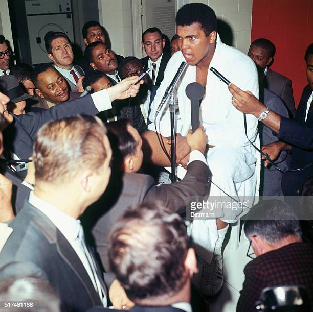 Muhammad Ali is interviewed by newsmen in dressing room following fight with challenger Cleveland Williams in which Ali retained his heavyweight title