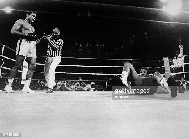 Muhammad Ali knocks George Foreman onto his back during the eighth round of their world heavyweight title boxing match in 1974.