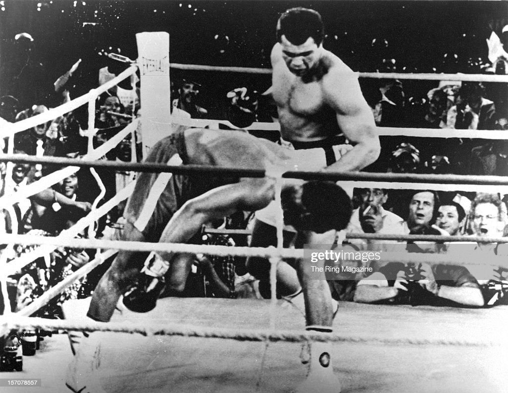 Muhammad Ali lands a left hook knocking out George Foreman during the 'Rumble in the Jungle' fight at the Mai 20 Stadium on October 30,1974 in Kinshasa,Zaire. Muhammad Ali won WBC heavyweight title and the WBA World heavyweight title W