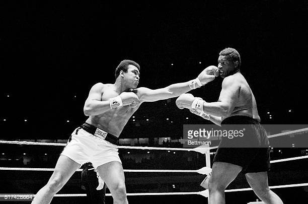 Muhammad Ali lands a left jab to the head of Buster Mathis in the first round of 12-round heavyweight bout in the Astrodome.