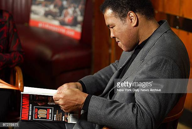 Muhammad Ali looks over his new magazine Muhammad during a promotional appearance at Gallagher's Steakhouse on W 52nd St