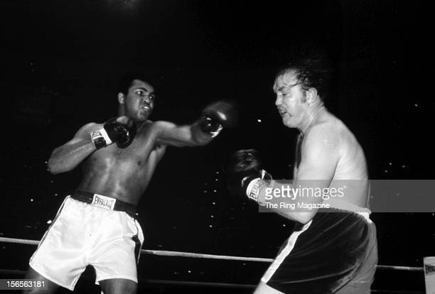 Muhammad Ali looks to connect a left hook to Chuck Wepner during a fight at Richfield Coliseum on March 24, 1975 in Richfield, Ohio. Muhammad Ali won...