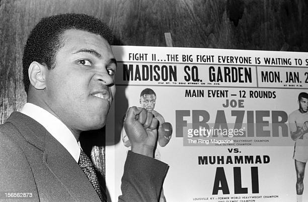 Muhammad Ali poses as he taunts Joe Frazier before the official press conference on January 171974 for bout II at Pen Restaurant in New York New York