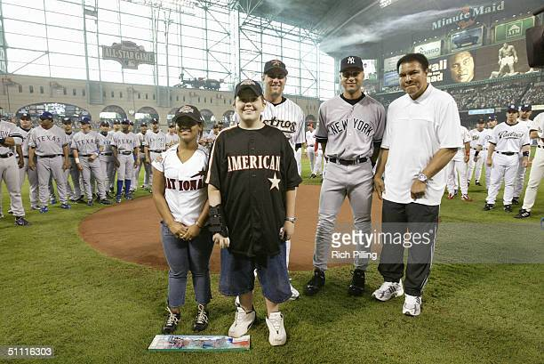 Muhammad Ali poses for a photo with Derek Jeter and Jeff Kent before the 2004 AllStar Game at Minute Maid Field on July 13 2004 in Houston Texas The...