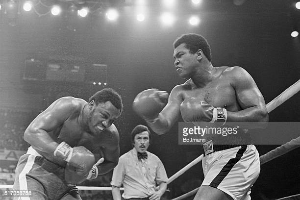 Muhammad Ali punches Joe Frazier in the head during the seventh round of their boxing match. Referee Carlos Padilla, Jr. Supervises this heavyweight...
