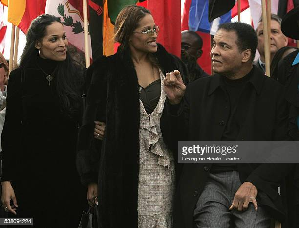Muhammad Ali right spends time with his daughters Jamillah left and Rasheeda at the dedication of the Muhammad Ali Center in Louisville Ky on...