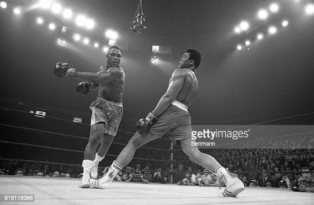 Muhammad Ali steps away from a roundhouse left thrown by Joe Frazier during their title bout here March 8th Frazier became undisputed heavyweight...