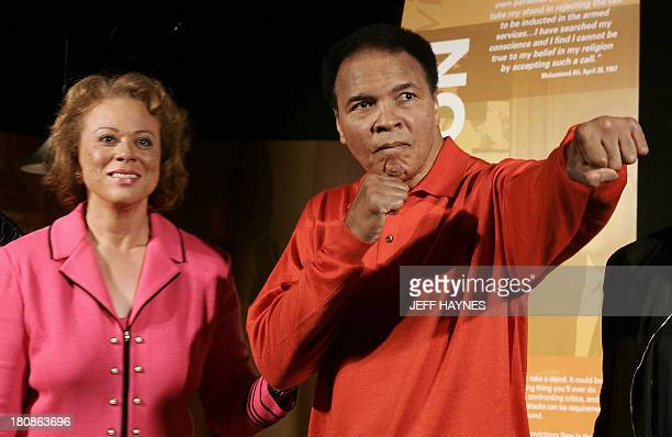 Muhammad Ali strikes a boxing pose with wife Lonnie at the Muhammad Ali Center 18 November 2005 in Louisville KY before the grand opening of the new...