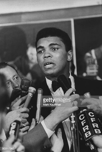 Muhammad Ali talking to reporters after his match against George Chuvalo in Toronto, which he won by a knockout in the third round.