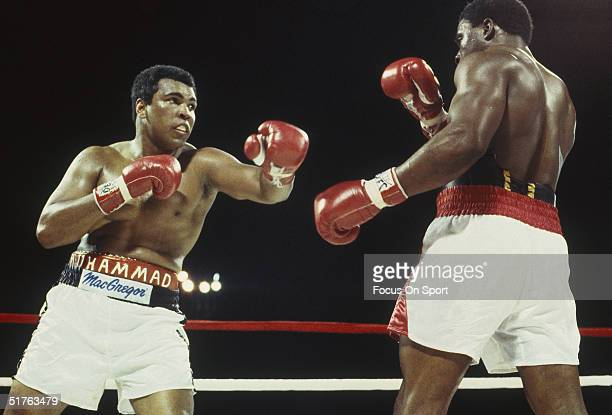 Muhammad Ali throws a left hook and misses Trevor Berbick at the Queen Elizabeth Sports Centre on December 11, 1981 in Nassau, Bahamas. Berbick...
