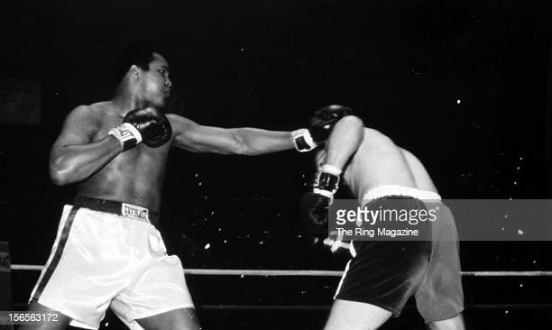 Muhammad Ali throws a left punch against Chuck Wepner during a fight at Richfield Coliseum on March 24, 1975 in Richfield, Ohio. Muhammad Ali won...