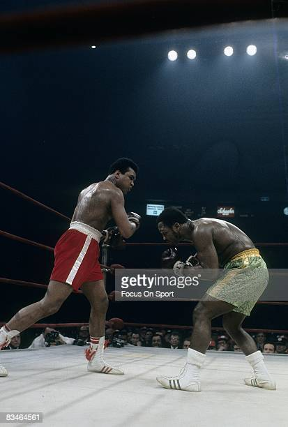 Muhammad Ali throws a punch at Joe Frazier during the WBC/WBA heavyweight title fight March 8 1971 at Madison Square Garden in New York New York