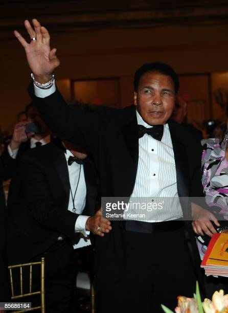 Muhammad Ali waves to fans during Muhammad Ali's Celebrity Fight Night XV held at the JW Marriott Desert Ridge Resort Spa on March 28 2009 in Phoenix...