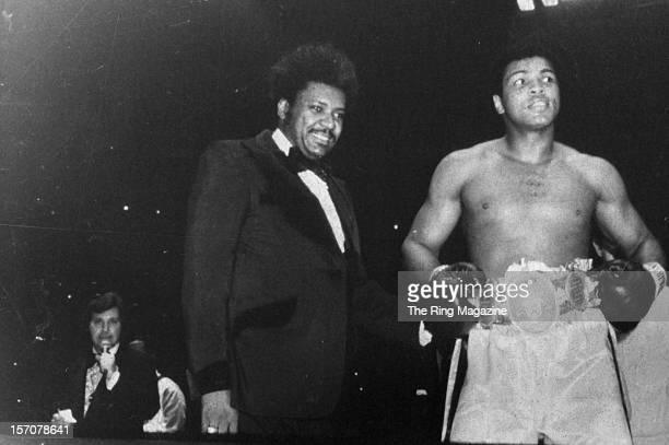 Muhammad Ali wears his belts in the ring after winning the fight against Chuck Wepner at Richfield Coliseum on March 241975 in ClevelandOhio Muhammad...