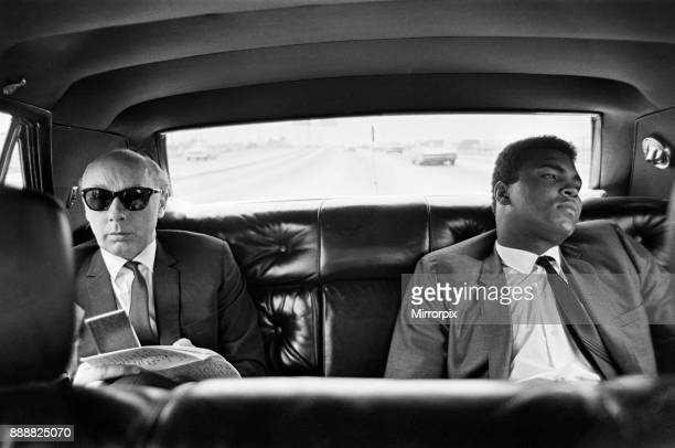Muhammad Ali with Daily Mirror reporter Donald Zec in the back of a car 31st August 1967
