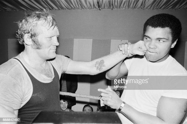 Muhammad Ali with future opponent British Heavyweight Champion Richard Dunn at the training camp of World Welterweight John H Stracey in London's...