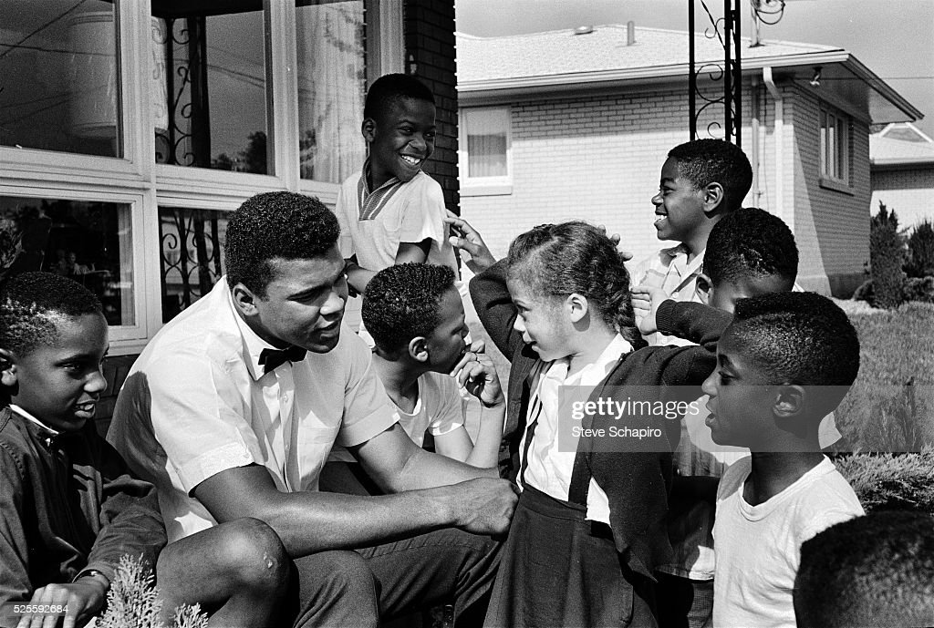 Muhammad Ali with neighborhood kids in Louisville, including Yolanda 'Lonnie' Williams who would become his wife in 1986.