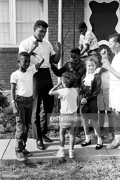 Muhammad Ali with neighborhood kids outside his mother's house in Louisville Kentucky including Yolanda Lonnie Williams who would become his wife in...