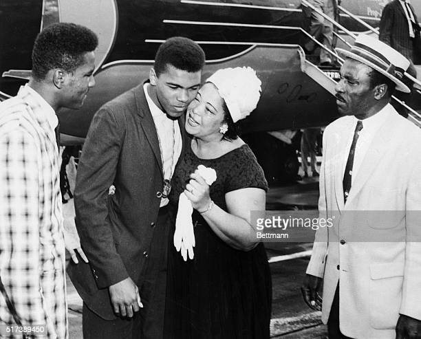 Muhammad Ali's parents and brother greet him as he arrives home in Louisville after winning a gold medal at the 1960 Olympics in Rome.
