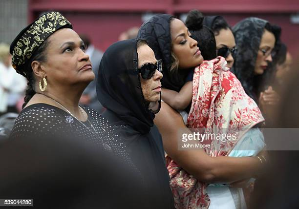 Muhammad Ali's second wife Khalilah CamachoAli his fourth wife Lonnie Ali and daughter Laila Ali holding a grandchild attend an Islamic prayer...