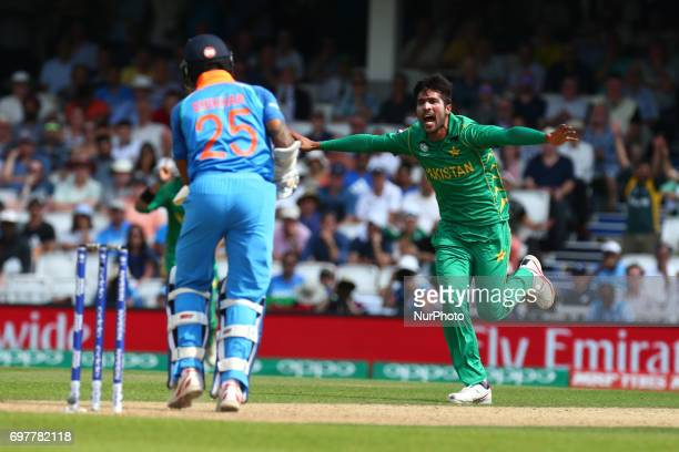 Muhammad Amir of Pakistan celebrate the wicket of Shikhar Dhawan of India during the ICC Champions Trophy Final match between India and Pakistan at...