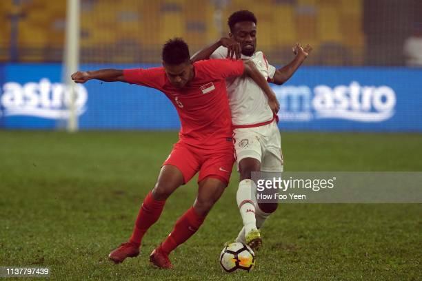 Muhammad Amirul Adli of Singapore blocks Mohsin Jouhar Bilal of Oman during the Airmarine Cup final between Singapore and Oman at Bukit Jalil...