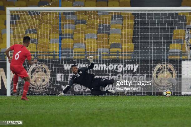 Muhammad Amirul Adli of Singapore in action during penalty shootout with Faiyz Issa Khadoom of Oman during the Airmarine Cup final between Singapore...