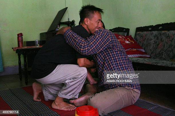 Muhammad Cholili who was convicted of helping to orchestrate terror attacks on the resort island of Bali in 2005 embraces his visiting fatherinlaw at...