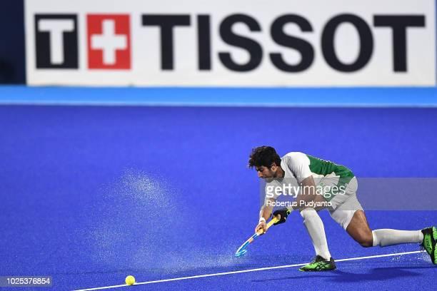 Muhammad Faizal Qadir of Pakistan shoots during the Men's Hockey Semifinals match between Japan and Pakistan on day twelve of the Asian Games on...